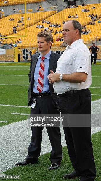 General managers Thomas Dimitroff of the Atlanta Falcons and Kevin Colbert of the Pittsburgh Steelers look on from the sideline before a preseason...