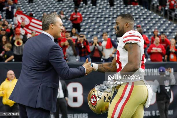 General manger John Lynch of the San Francisco 49ers congratulates Carlos Hyde after the game against the Houston Texans at NRG Stadium on December...