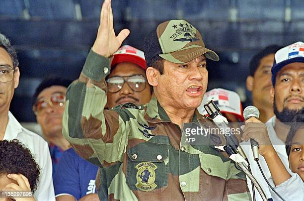 General Manuel Antonio Noriega speaks 20 May 1988 in Panama City during the presentation of colors to the San Miguel Arcangel de San Miguelito...