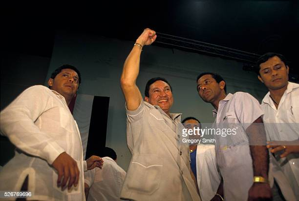 General Manuel Noriega raises his fist as he is surrounded by supporters Photo taken in February 1988