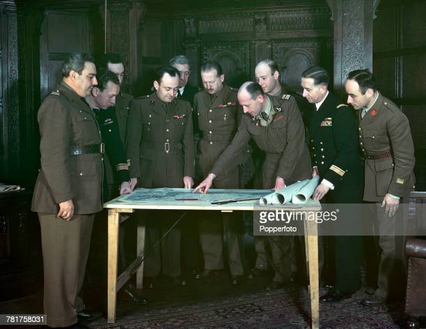 General MariePierre Koenig recently appointed Commander of the French Forces of the Interior pictured at a map table with his staff from left to...