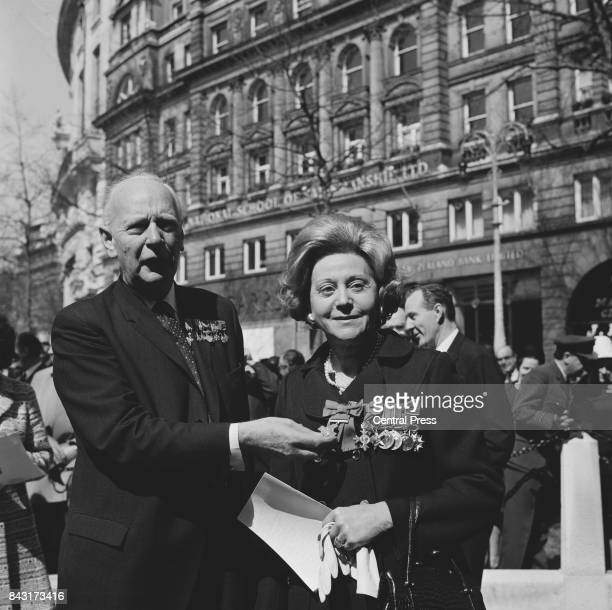 General MariePierre Koenig wartime leader of the French Resistance holds the George Cross worn by Odette Hallowes GC a former Allied intelligence...