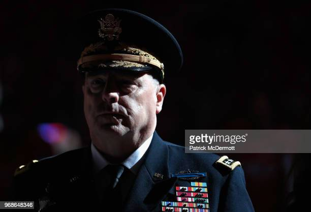 General Mark A Milley Chief of Staff of the United States Army stands on the ice during the national anthem before Game Four of the 2018 NHL Stanley...