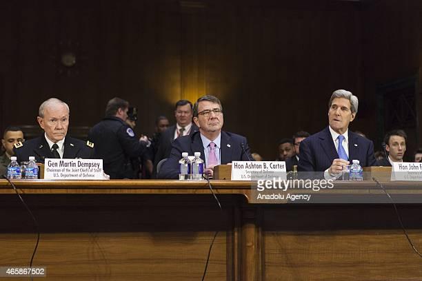 General Martin Dempsey Chairman of the Joint Chiefs of Staff Secretary of State John Kerry and Secretary of Defense Ashton Carter listen to Senators...
