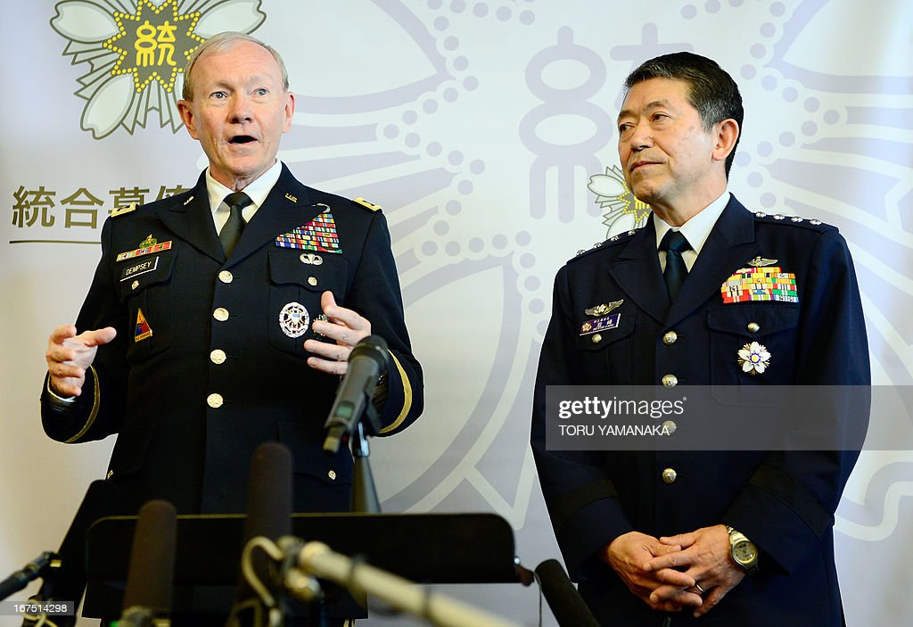 General Martin Dempsey (L), chairman of the US Joint Chiefs of Staff, answers questions during a joint press interview with his Japanese counterpart Shigeru Iwasaki (R) after their talks at the Defence Ministry in Tokyo on April 26, 2013. The US's top military officer said in Japan on April 25 that his troops were ready to act if North Korea turned its increasingly bellicose rhetoric into action. AFP PHOTO / Toru YAMANAKA