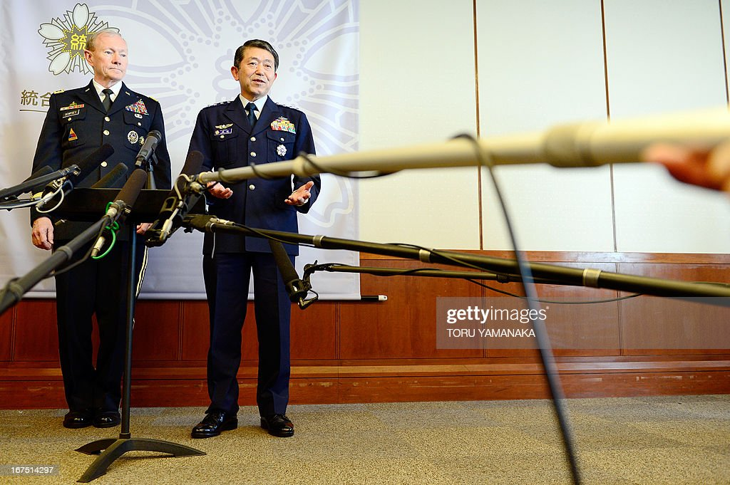 General Martin Dempsey (L), chairman of the US Joint Chiefs of Staff, listens to his Japanese counterpart Shigeru Iwasaki (R) during a joint press interview after their talks at the Defence Ministry in Tokyo on April 26, 2013. The US's top military officer said in Japan on April 25 that his troops were ready to act if North Korea turned its increasingly bellicose rhetoric into action. AFP PHOTO / Toru YAMANAKA