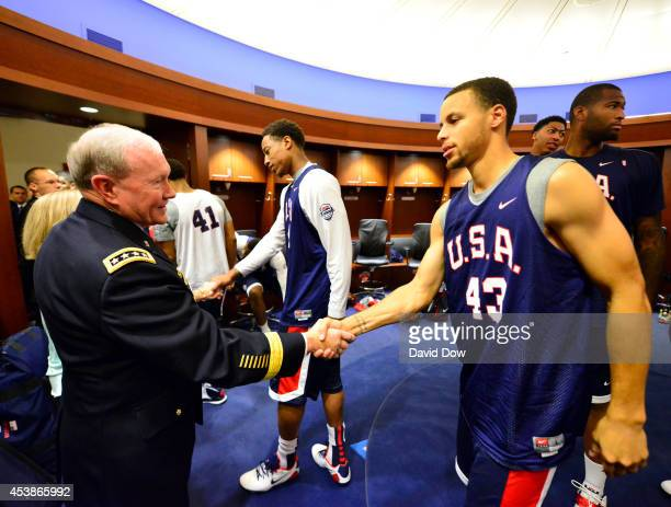 General Martin E Dempsey Chairman of the Joint Chiefs of Staff shakes hands with Stephen Curry of the USA Men's National National Team during...
