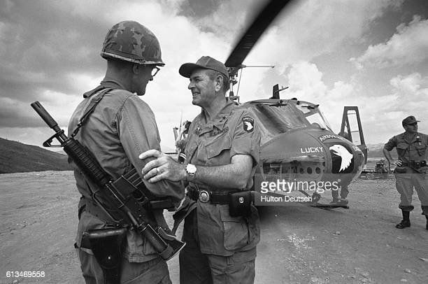 General Melvin Zais the commanding gerenal of the United States Army 101st Airborne Division serving in Vietnam is greeted by a fellow officer