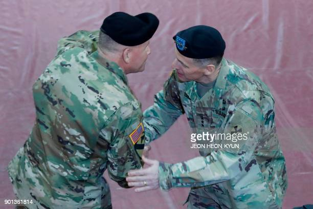 US General Michael A Bills incoming commanding general and Eighth Army chief of staff of the ROKUS Combined Forces Command shakes hands with outgoing...