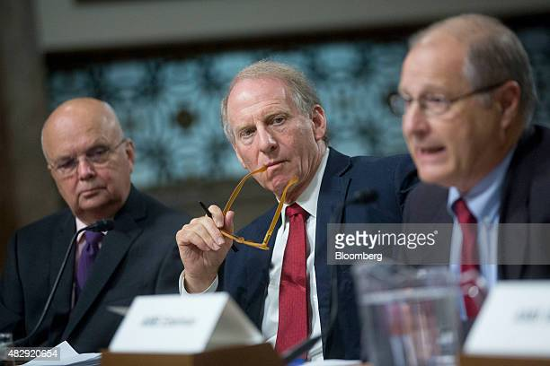 General Michael Hayden principal of the Chertoff Group and former director of the Central Intelligence Agency from left and Richard Haass president...
