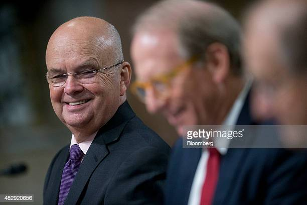 General Michael Hayden principal of the Chertoff Group and former director of the Central Intelligence Agency left smiles as Richard Haass president...