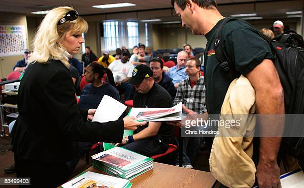 General Motors auto worker gets information from Marie Davis of the Montgomery County Job Center during a seminar about finding a new job in a...
