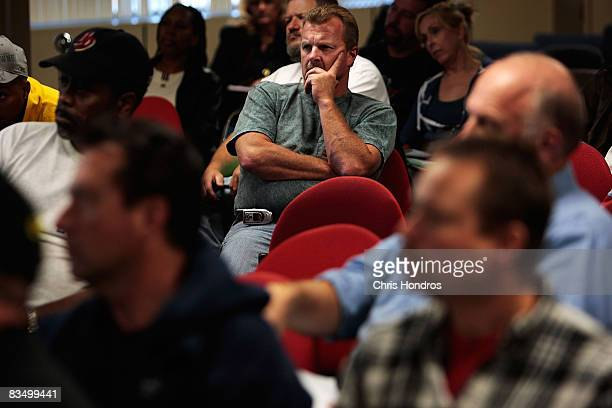 General Motors auto workers listen at a seminar about finding a new job in a conference room in their factory October 30 2008 in Moraine a suburb of...