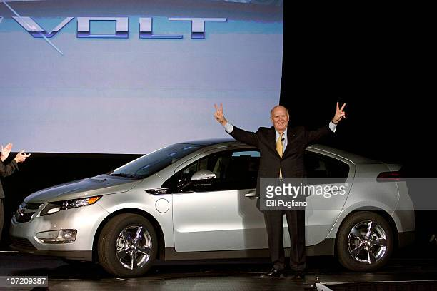 General Motors' CEO Dan Akerson celebrates the rollout of the Chevrolet Volt hybrid electric vehicle after he drove Volt VIN# 00001 on stage at...