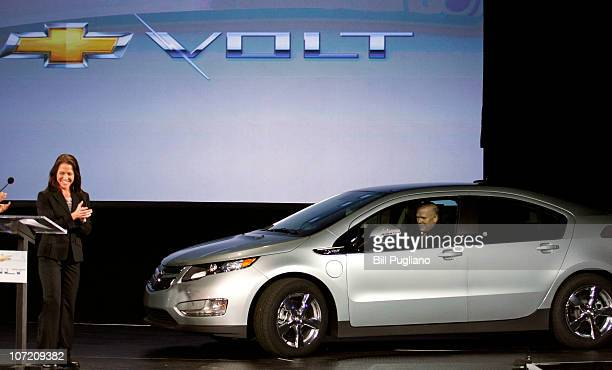 General Motors' CEO Dan Akerson drives Chevrolet Volt hybrid electric vehicle VIN# 00001 on stage for its official rollout at DetroitHamtramck...