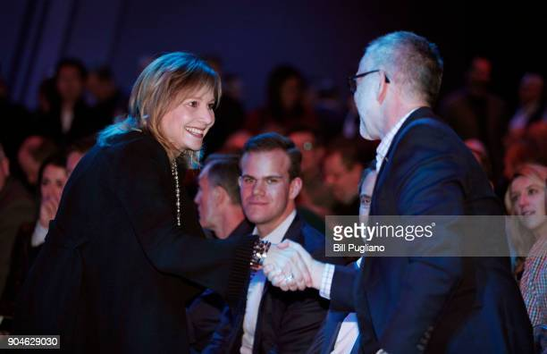 General Motors CEO Mary Barra shakes hands at the official debut of the new 2019 Chevrolet Silverado 1500 at the 2018 North American International...
