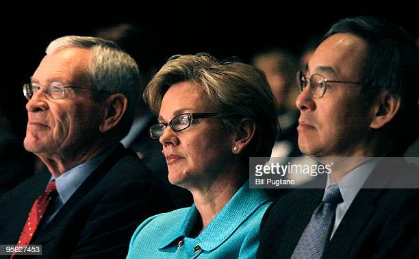 General Motors Chairman and CEO Ed Whitacre Michigan Gov Jennifer Granholm and US Secretary of Energy Steven Chu wait to speak at an event where the...