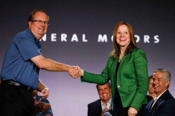 MI: GM and Auto Workers Union Hold Ceremonial Handshake Ahead Of Labor Talks