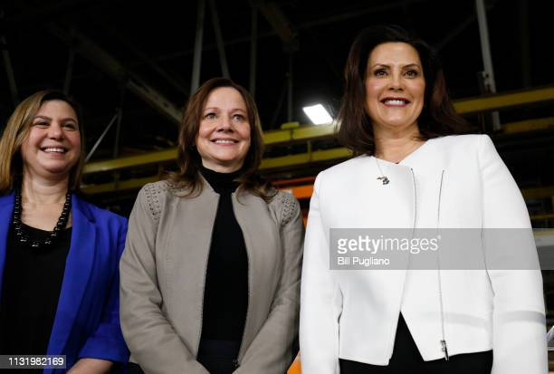 General Motors Chairman and CEO Mary Barra stands on stage with Michigan Gov Gretchen Whitmer and Rep Elissa Slotkin after she announced a $300...