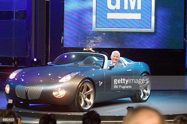 General Motors Chairman of North American Operations Bob Lutz drives the Pontiac Solstice onto the stage at the 2002 North American International...