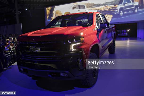 A General Motors Co 2019 Chevrolet Silverado pickup truck is driven at an event during the 2018 North American International Auto Show in Detroit...