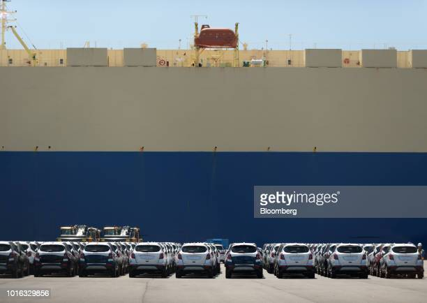 General Motors Co Brick Encore vehicles stand at the Nagoya Port in Nagoya Japan on Tuesday July 31 2018 Japan is scheduled to release trade balance...