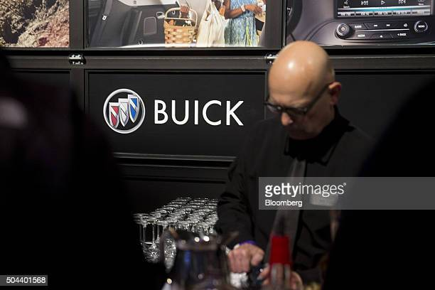 General Motors Co Buick signage is displayed at a bar during an event ahead of the 2016 North American Auto Show in Detroit Michigan US on Sunday Jan...