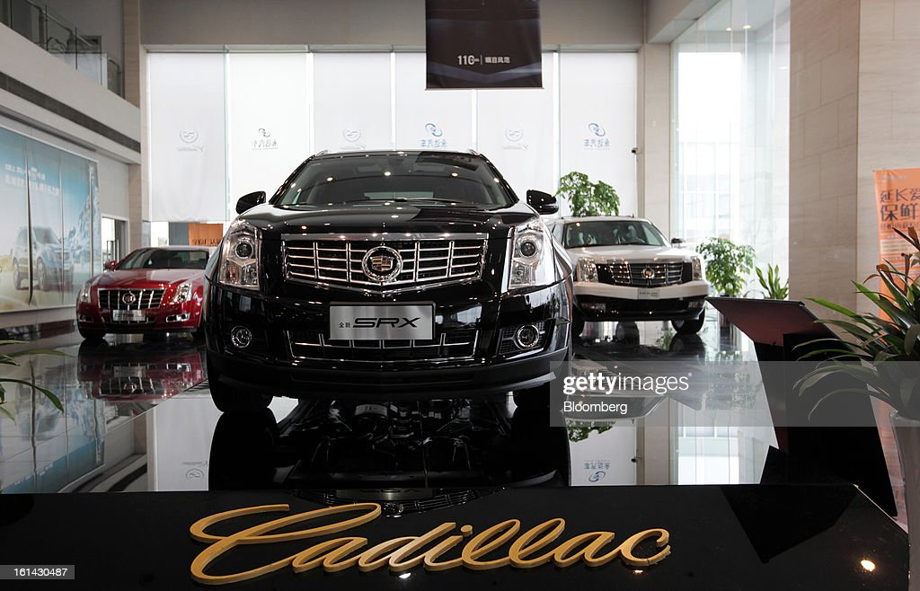 General Motors Co. Cadillac CTS, left, SRX, center, and a Escalade Hybrid vehicle are displayed at a dealership in Shanghai, China, on Friday, Feb. 8, 2013. China's services industries grew at the fastest pace since August as gains in retailing and construction aid government efforts to drive a recovery in the world's second-biggest economy. Photographer: Tomohiro Ohsumi/Bloomberg via Getty Images