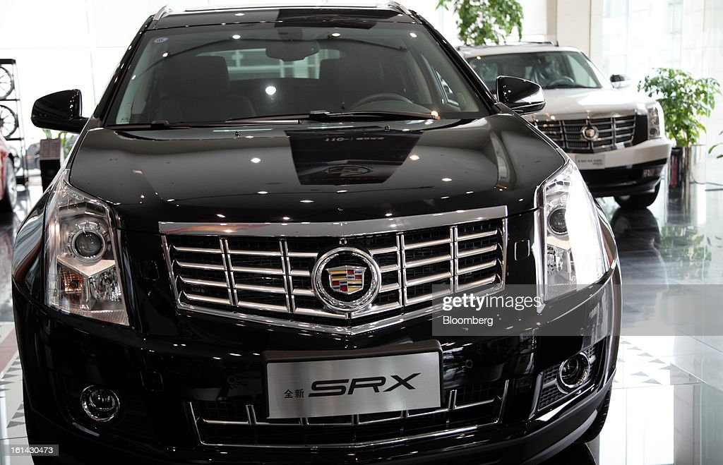 A General Motors Co. Cadillac SRX, left, and Escalade Hybrid sports utility vehicle (SUV) are displayed at a dealership in Shanghai, China, on Friday, Feb. 8, 2013. China's services industries grew at the fastest pace since August as gains in retailing and construction aid government efforts to drive a recovery in the world's second-biggest economy. Photographer: Tomohiro Ohsumi/Bloomberg via Getty Images