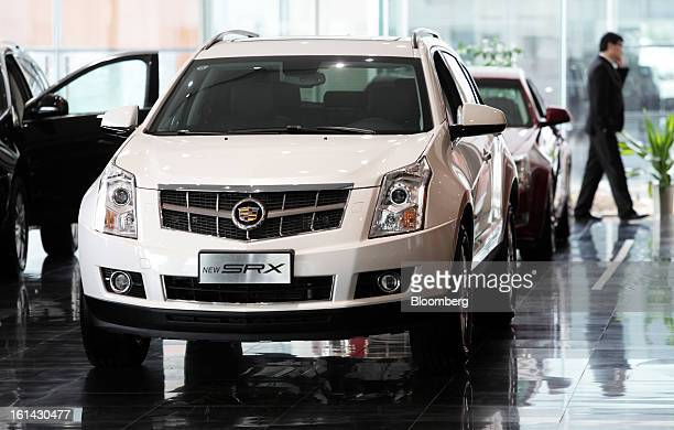 A General Motors Co Cadillac SRX sports utility vehicle is displayed at a dealership in Shanghai China on Friday Feb 8 2013 China's services...