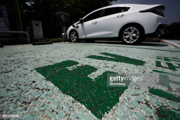 A General Motors Co Chevrolet 2017 Volt hybrid electric vehicle sits parked while charging at a charging station in Jeju South Korea on Wednesday...