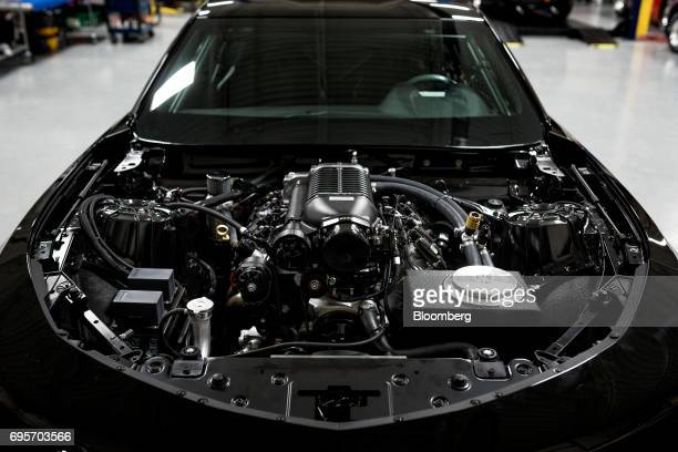 A General Motors Co Chevrolet COPO Camaro performance engine sits displayed inside of a vehicle at the company's build center in Oxford Michigan US...