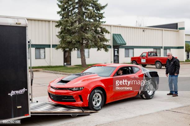 A General Motors Co Chevrolet COPO Camaro performance vehicle is driven into a trailer outside of the company's build center in Oxford Michigan US on...