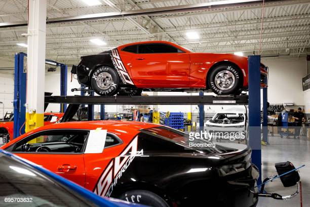 General Motors Co Chevrolet COPO Camaro performance vehicles sit inside the company's build center in Oxford Michigan US on Friday April 21 2017 The...