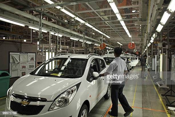 A General Motors Co employee works at the company's manufacturing plant in Talegaon India on Tuesday May 18 2010 In India GM eventually plans to make...