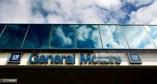 General Motors Co signage is displayed outside of the company's assembly plant in Oshawa Ontario Canada on Monday Aug 8 2011 General Motors of Canada...