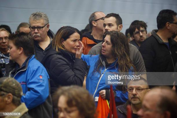 A General Motors Co worker reacts during an information meeting at Unifor Union Hall in Oshawa Ontario Canada on Monday Nov 26 2018 After churning...