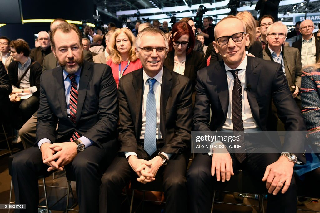 General Motors President Dan Ammann, CEO of PSA Carlos Tavares and CEO of Opel group Karl-Thomas Neumann sit before a press conference during the 87th Geneva International Motor Show in Geneva, on March 7, 2017, a day after French carmaker PSA announced the acquisition of General Motors' European subsidiary, which includes the Opel and Vauxhall brands. Europe's biggest annual car show kicks off in Geneva with luxury and crossover vehicles under the limelight, but with the emissions scandal still hanging over the industry. /