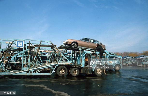 General Motors vehicles are photographed been loaded onto a transporter at the General Motors Assembly plant January 12 1982 in Tarrytown New York