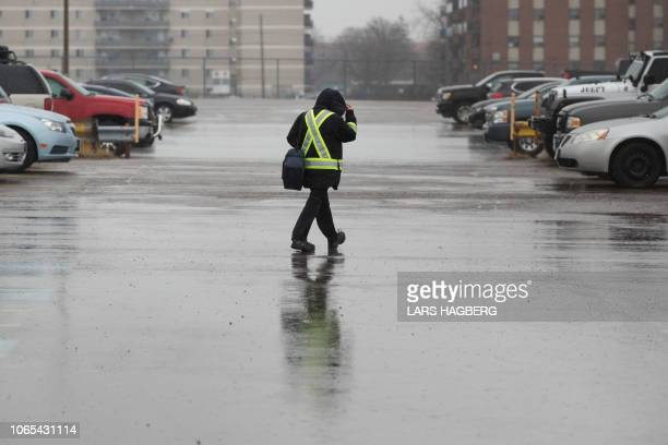 A General Motors worker leaves the Oshawa General Motors plant in Oshawa Ontario on November 26 2018 General Motors is to announce on Monday the...