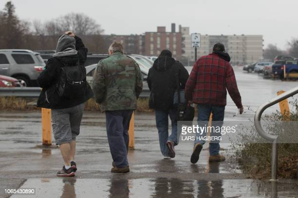 General Motors workers leave the Oshawa General Motors plant in Oshawa Ontario on November 26 2018 General Motors is to announce on Monday the...
