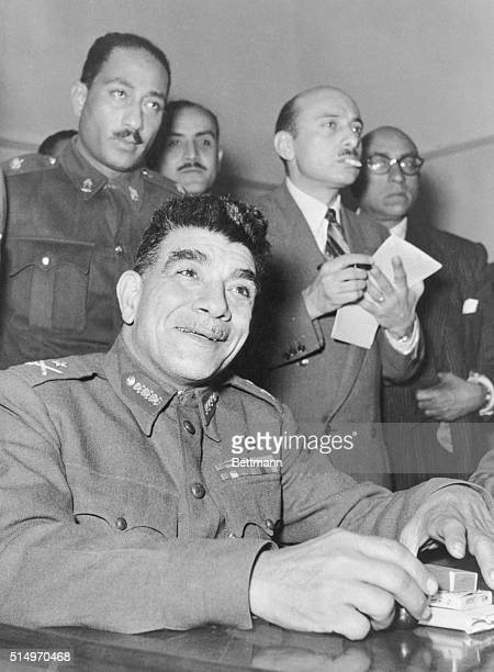 General Naguib Egypt's 'strong man' greets foreign correspondents with a smile here just before the press conference on January 17th at which he...