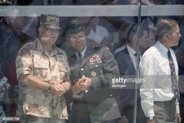 General Norman Schwarzkopf and Joint Chiefs of Staff Chairman General Colin Powell watch the Desert Storm victory parade from the reviewing stand