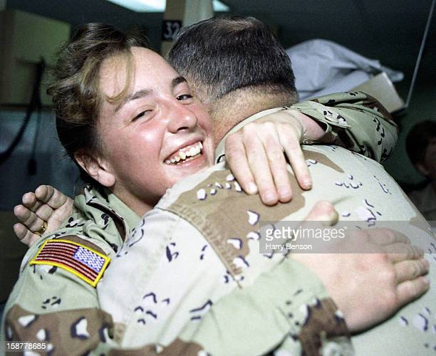 General Norman Schwarzkopf hugging the first woman soldier POW photographed for Life Magazine in February in Bahrain