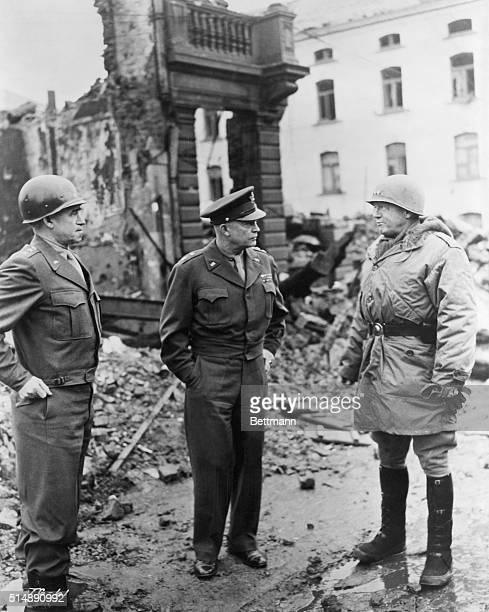 General Omar Bradley, General Dwight Eisenhower and General George Patton survey war damage in Bastogne, Belgium in this photo.