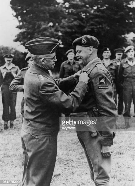 General Omar Bradley of the US Army, pins the Legion of Merit onto Major General Richard Gale , Commander of an Airborne Division of the British...