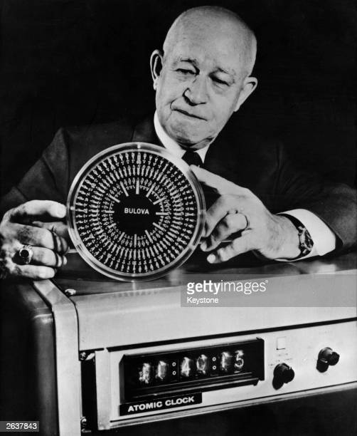 General Omar Bradley who commanded the 12th US Army during the D-Day landings. He is showing a rock crystal clock produced by his company as well as...