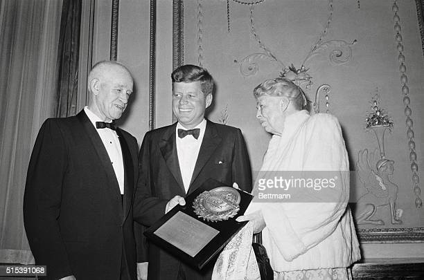 General Omar N. Bradley receives first World Peace Through Health award from President John F. Kennedy and Eleanor Roosevelt .