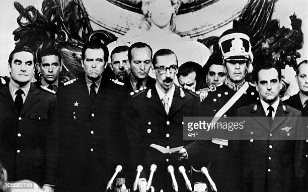 General Orlando Ramon Agosti and Admiral Emilio Massera stand as Lieutenant General Jorge Rafael Videla , President of Argentina, after takes an oath...