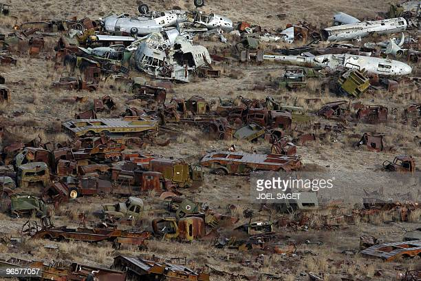 A general overview of a junkyard of Soviet armoured vehicles planes and tanks at the Kabul Military Training Camp near the capital on January 13 2010...